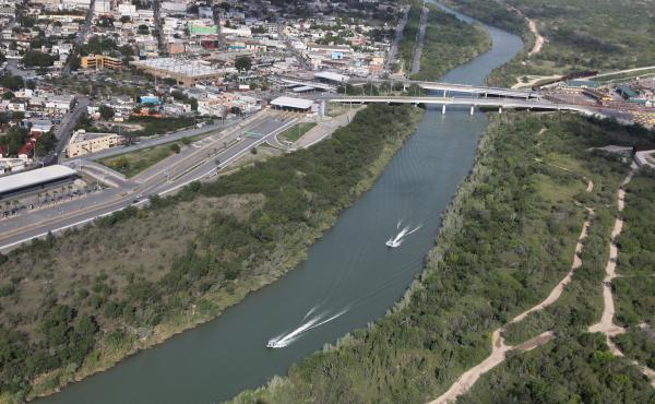 U.S. Border Patrol boats move along the Rio Grande near an international crossing between the United States and Mexico on March 16. Customs and Border Protection have announced that apprehensions along the southwest border dropped in both February and Mar