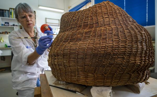 Conservation work on the basket in the Israel Antiquities Authority's laboratories.