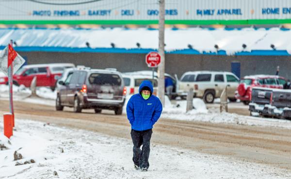 A man wears a mask as the territory of Nunavut enters a two week mandatory restriction period in Iqaluit, Nunavut, Canada, on Wednesday. More than 80 COVID-19 cases have been identified this month in Nunavut, where around 39,000 people, predominantly Inui