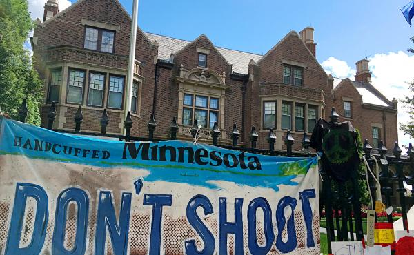 """Protesters camped out in front of the Minnesota Governor's Residence, calling for more """"judgment"""" by police officers. Many say officers are too quick to shoot people whom they perceive as threats."""