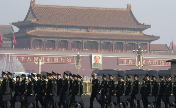 Chinese military delegates arrive for the National People's Congress in Beijing last March. The growing friction between the U.S. and China, combined with the rapid rise of China's economy and its military, has stirred a debate about whether the U.S. and