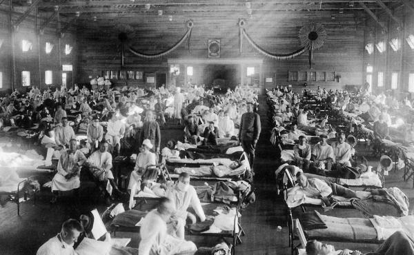 """Patients are treated at an Army ward in Kansas during the influenza epidemic of 1918. About 675,000 Americans died of the flu known as """"la grippe."""""""