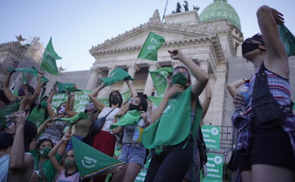 Abortion-rights activists in favor of a bill legalizing abortion gather outside the legislative building in Buenos Aires, Argentina, on Thursday.