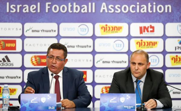 Ofer Eini and Rotem Kamer, president and CEO of the Israeli Football Association, respectively, address the media Wednesday in the town of Ramat Gan, east of Tel Aviv. The men announced that the organization will file a formal complaint to FIFA against th