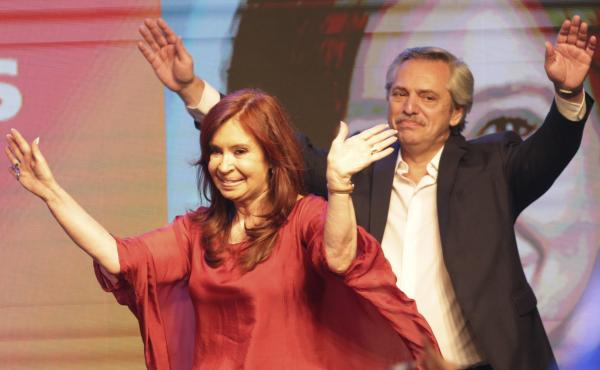 Peronist presidential candidate Alberto Fernández and running mate, former President Cristina Fernández de Kirchner, wave to supporters after incumbent President Mauricio Macri conceded defeat at the end of election day in Buenos Aires, Argentina, Sunda