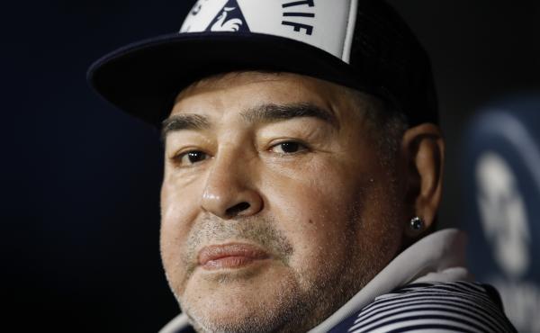 Diego Maradona, coach of Gimnasia y Esgrima, sits on the bench prior to Argentina's soccer league match against Boca Juniors at La Bombonera stadium in Buenos Aires, Argentina, in March.