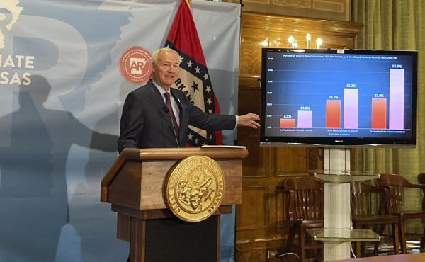 Arkansas Gov. Asa Hutchinson stands next to a chart displaying COVID-19 hospitalization data as he speaks at a news conference at the state Capitol in Little Rock, Ark., Thursday, July 29, 2021.