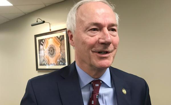 Arkansas Gov. Asa Hutchinson on Tuesday signed into law a bill banning nearly all abortions in the state, a sweeping measure that supporters hope will force the U.S. Supreme Court to revisit its landmark Roe v. Wade decision.