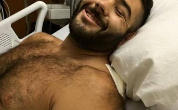 An image of Chris Mintz recovering in the hospital was posted online by his cousin. Mintz is being called a hero for trying to block a gunman from reaching his classmates at Umpqua Community College.
