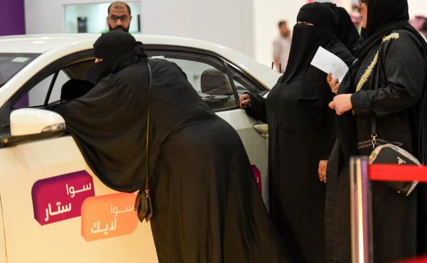 Saudi women check out cars at an automotive exhibition for women in the Saudi capital Riyadh on May 13.