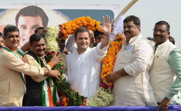 Rahul Gandhi (center), the new president of the Indian National Congress, waves while being garlanded during a political rally at Chilloda village on Nov. 11. Gandhi takes over the party leadership this week from his mother, Sonia Gandhi, who steps down a