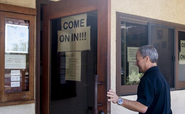Fume Bistro owner Terry Letson enters his restaurant in Napa, Calif., on Tuesday. A handful of businesses in Napa have made the decision to begin reopening their dining rooms with occupancy limits