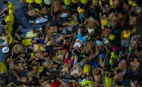 Prison inmates gather in cramped conditions in Manila's Quezon City Jail. Guards and inmates at the notoriously overcrowded Philippine jail tested positive for the COVID-19 coronavirus, officials said last month, sparking urgent calls for the release of s