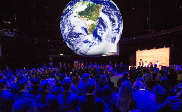 Climate conference attendees in Bonn, Germany, see a representation of Earth's climate trends.