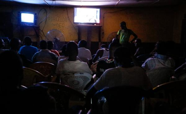 At the Arsenal video club, men sit shoulder to shoulder. But some still say it's too dangerous to go in because of Ebola.
