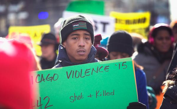 Demonstrators calling for an end to gun violence and the resignation of Mayor Rahm Emanuel march through downtown Chicago on December 31. More than 500 Chicagoans have been killed so far in 2016.