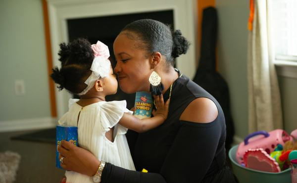 Brittany Smith and her daughter at their home. The family has flourished in Charlotte. Two years ago, Smith and her husband bought a custom-built house and both found new work opportunities.