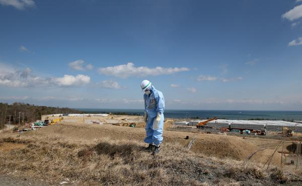 An employee of Tokyo Electric Power Co. works at Japan's Fukushima Dai-ichi nuclear power plant to decontaminate the area after the 2011 nuclear meltdown. A Vietnamese laborer in Japan on a training program says he was also put to work cleaning up the sit