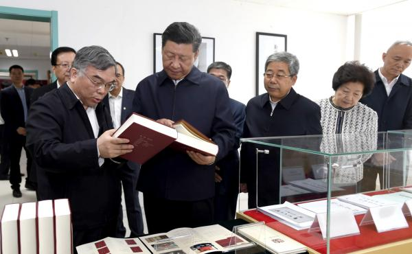Chinese President Xi Jinping visits the Marxist literature center at Peking University, long a bastion of patriotic student activism, in Beijing on Wednesday. Xi has pushed China's universities to enforce ideological conformity and avoid discussing consti
