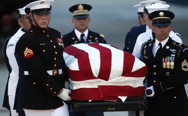 The flag-draped casket of Sen. John McCain, R-Ariz., is carried by an Armed Forces body bearer team to a hearse, on Thursday  at Joint Base Andrews, Md.
