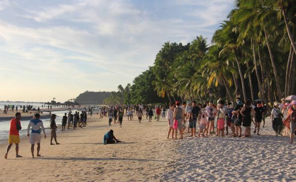 Tourists walk along a beach in Malay town, on the Philippine island Boracay, last week. President Duterte's decision to close Boracay has rocked the island. The Philippines is set to deploy hundreds of riot police to keep travelers out and head off potent