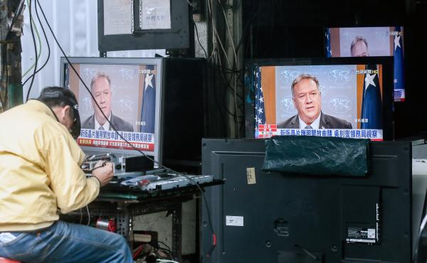 Televisions show a news broadcast of U.S. Secretary of State Mike Pompeo in Taipei, Taiwan, on Jan. 11. The Trump administration removed decades-old restrictions on interactions with Taiwanese officials just days before President-elect Joe Biden's inaugur