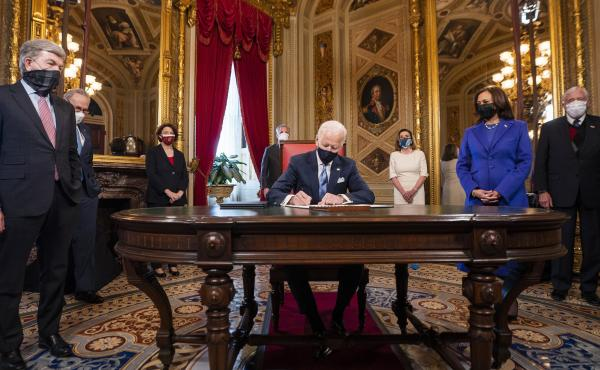 President Joe Biden signs three documents including an inauguration declaration, cabinet nominations and sub-cabinet nominations in the President's Room at the US Capitol after the inauguration ceremony, Wednesday.