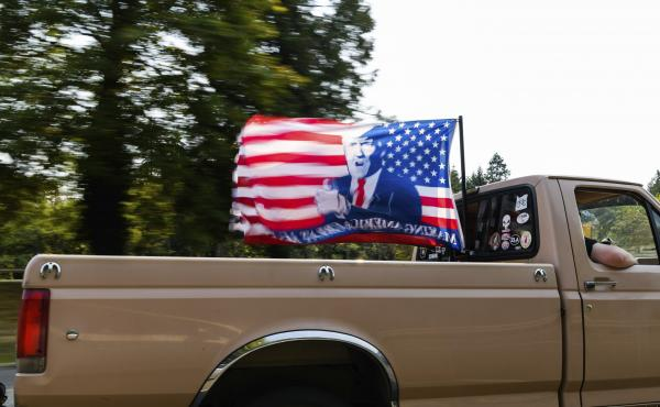 """A caravan of vehicles make their way along the Interstate 205 South freeway during the """"Oregon for Trump 2020 Labor Day Cruise Rally,"""" at Clackamas Community College in Oregon City, Ore., on Sept. 7, 2020."""