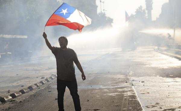An anti-government protester waves Chile's flag in Santiago, on Oct. 29, 2019.