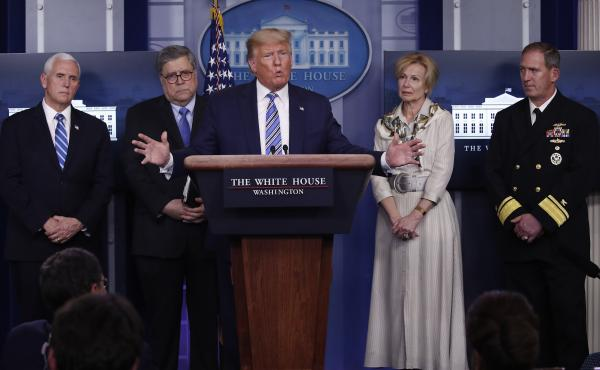 President Trump takes questions from reporters Monday. Joining him at the press briefing on coronavirus are Vice President Pence; Attorney General William Barr; Dr. Deborah Birx, White House coronavirus response coordinator; and Navy Rear Adm. John Polowc