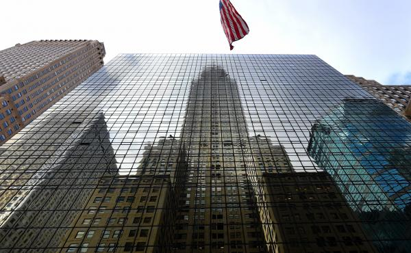 The Chrysler Building is reflected in the side of the Grand Hyatt Hotel in midtown Manhattan. The hotel on East 42nd Street was Donald Trump's first major development project.