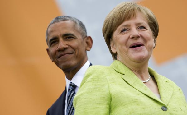 German Chancellor Angela Merkel and former President of the United States Barack Obama arrive for a discussion on democracy in Berlin Thursday.