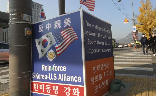 """A billboard supporting the alliance between South Korea and the U.S. is displayed near the U.S. Embassy in Seoul on Thursday. The banner at top reads, """"Anti-China and Pro-the U.S."""""""