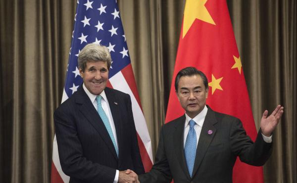 Secretary of State John Kerry and Chinese Foreign Minister Wang Yi meet on the sidelines of the Asia-Pacific Economic Cooperation (APEC) meeting in Beijing on Friday. Beijing and Washington backed an anti-corruption pact.