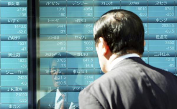 A man looks at an electronic stock board showing Japan's Nikkei 225 index on Thursday in Tokyo.