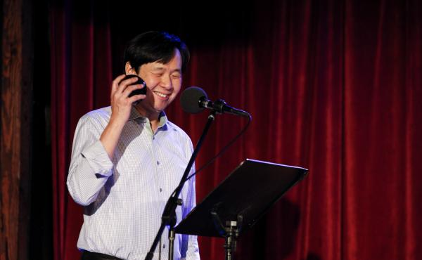 Puzzle Guru Art Chung leads a game with his Magic 8-Ball on Ask Me Another at the Bell House in Brooklyn, New York.