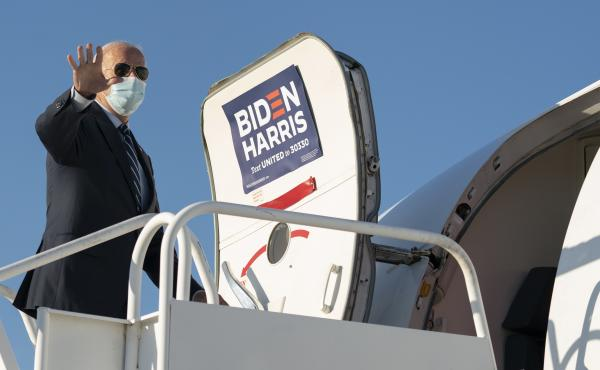 Democratic presidential nominee Joe Biden boards his campaign plane.