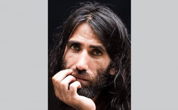 Behrouz Boochani, a Kurdish-Iranian journalist and asylum-seeker, won two prestigious Australian literary prizes for his debut, a book composed in text messages sent from a detention center on Manus Island.