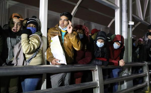 Cuban migrants block the Paso del Norte-Santa Fe international bridge between Mexico and the United States, to demand that the Trump administration allow them to wait for their asylum process on U.S. soil, in Ciudad Juarez, Mexico, on Dec. 29, 2020.