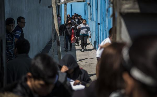 Central American migrants, sent from the United States, walk out in the streets of Guatemala City after arriving at the airport on Feb. 13, 2020. When asylum-seekers land in Guatemala, they are processed by immigration and asked if they want to stay in Gu