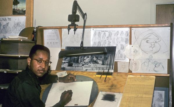 "Floyd Norman was Disney's first African-American animator. He's shown above in 1956, working as an ""apprentice inbetweener"" on Sleeping Beauty."