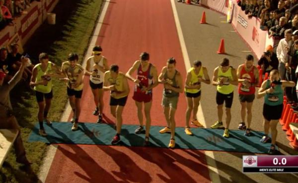 In an image from video of the men's event at the Beer Mile World Championships, competitors are seen poised to open their beers, which they'll guzzle before taking off on their first of four laps.