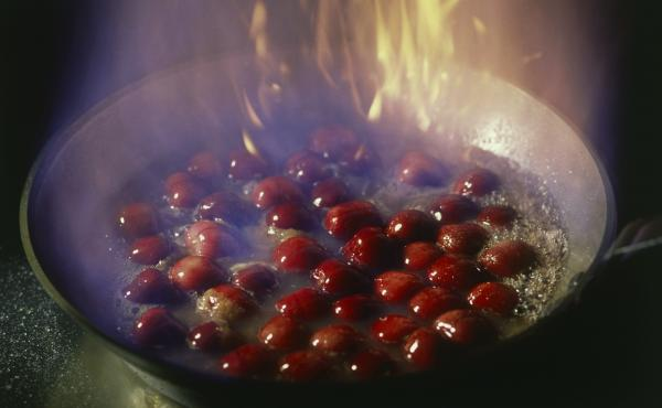 Archivist Amy McDonald invited some co-workers to help her re-create cherries jubilee from a university cookbook. But even with a historical paper trail, there were still things they couldn't figure out, like what to do after it starts flaming.