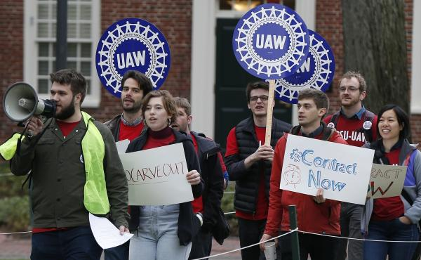 Union members protest at Harvard University in May over an increasing number of harassment and discrimination cases. The union began an indefinite strike Tuesday, with one of its key proposals aimed at strengthening protections against harassment and disc