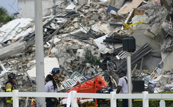 Emergency personnel work at the scene of a collapse of a 12-story condo building in the Surfside area of Miami.