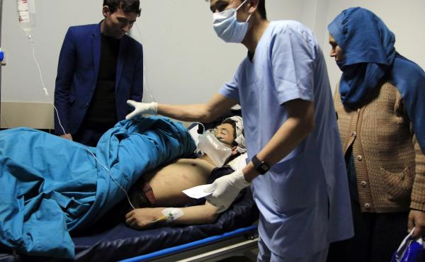 Patients are treated at a hospital after a suicide attack in Kabul, Afghanistan, on Saturday. Dozens were injured.