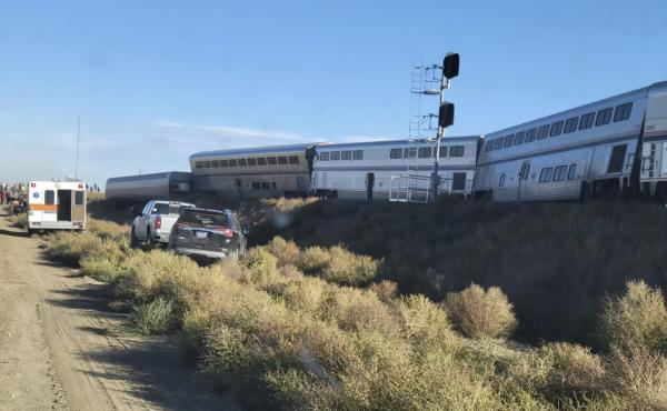 An ambulance is parked at the scene of an Amtrak train derailment on Saturday, in north-central Montana.