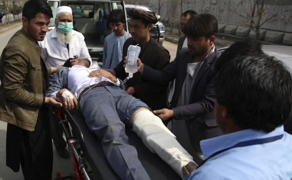 Emergency response workers load an injured man into an ambulance after an attack Friday in the Afghan capital, Kabul, left more than two dozen people dead.