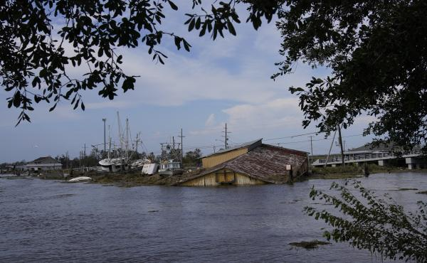 Flood damaged buildings and boats in the aftermath of Hurricane Ida, on Wednesday in Lafitte, La.