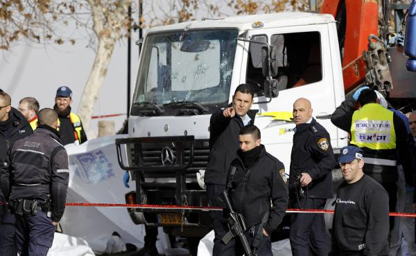 Israeli security forces and emergency personnel gather at the site of a vehicle-ramming attack in Jerusalem on Sunday.